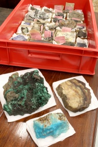 A tray containing Tourmaline specimens; with Malachite, Calcite and Smithsonite.